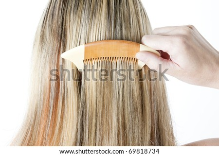 detail of woman combing long hair