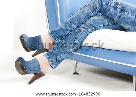 detail of woman wearing denim clogs - stock photo