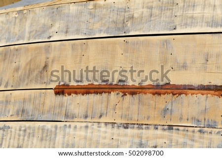 detail of wood texture in fishing boat abandoned