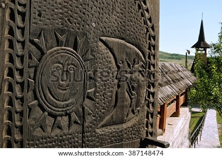 detail of wooden carved gate of Church in Bratesti, Romania - stock photo