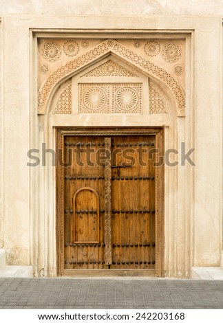 Detail of wooden door at Shaikh Isa bin Ali House in Al Muharraq, Bahrain, Middle East - stock photo