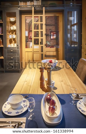 detail of wooden kitchen - stock photo