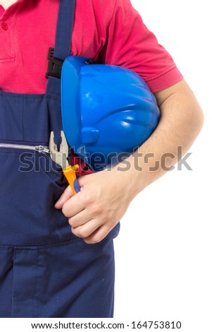 Detail of worker holding helmet and pliers