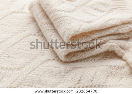 Detail of woven woolen design texture and sleeve. Fabric white background