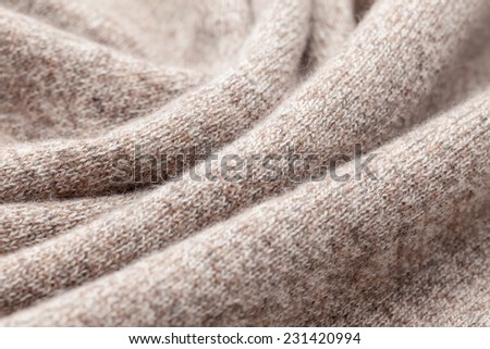 Detail of woven woolen design texture. Fabric brown background - stock photo