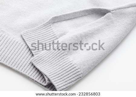 Detail of woven woolen design texture. Fabric grey background