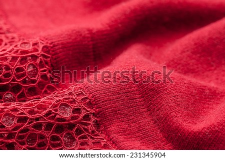 Detail of woven woolen design texture. Fabric red background - stock photo