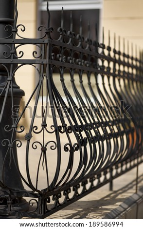detail of wrought iron railing with beautiful ornaments - stock photo