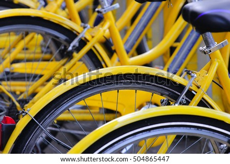detail of yellow bicycles at parking area, urban transportation concept