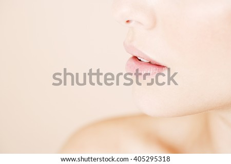 Detail of young woman's face showing mouth and chin - stock photo
