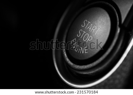 Detail on a black start button in a car.