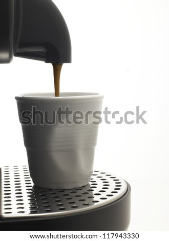 Detail on a white background a coffee machine with fake plastic cup - stock photo