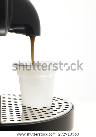 Detail on a white background a coffee machine with plastic cup - stock photo