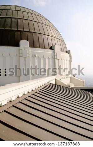 Detail on Griffith Observatory in late afternoon with Los Angeles, California in the background - stock photo
