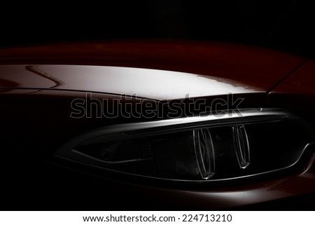 Detail on one of the LED headlights of a car. - stock photo