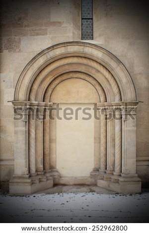 detail on romanic church, closed side entrance - stock photo