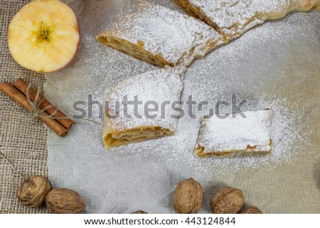Detail on Sugared Homemade Apple Strudel on a Baking Paper Top View - stock photo