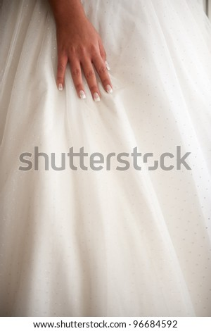 detail on the bride  hand over the wedding dress