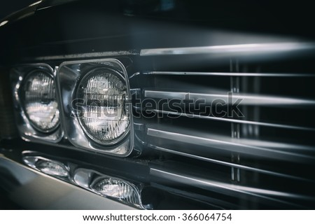 Detail on the headlight of a vintage car. - stock photo
