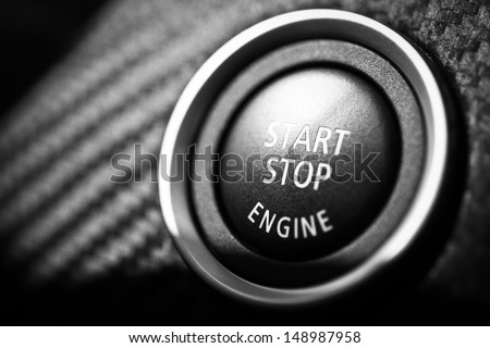Detail on the start button in a car - stock photo