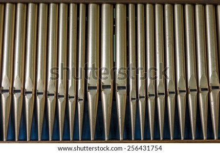 Detail organ pipe tubes in a church. - stock photo