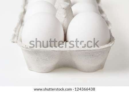 detail photo of open container with eggs, can be used as a background - stock photo