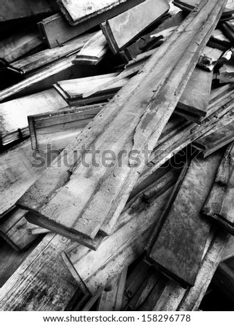 Detail pile of old wooden boards