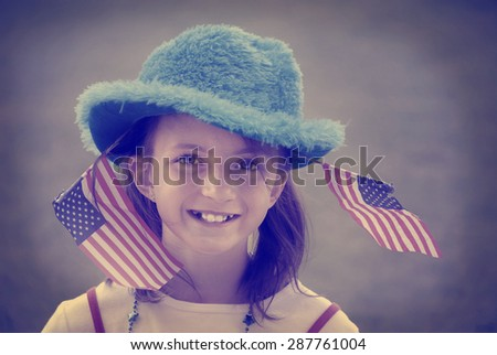Detail portrait of girl with patriotic flags instagram style - stock photo