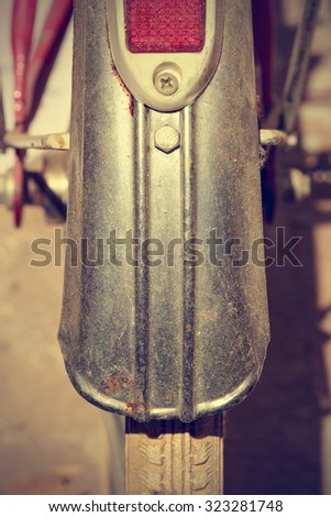 Detail retro bicycle fender. It looks part of the brake and wheel. Vintage style. Vertical image.