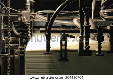 detail sheet feeder for offset printing machine - stock photo