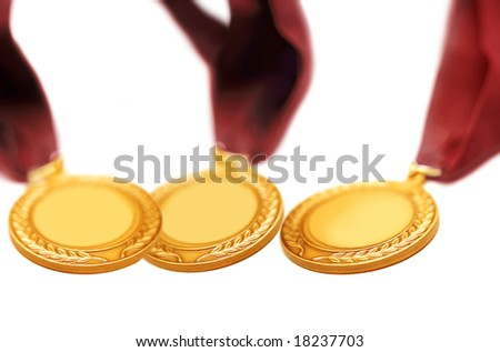 detail shot of a gold medals with red ribbon - stock photo