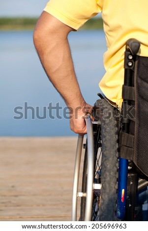 Detail shot of a man operating wheelchair
