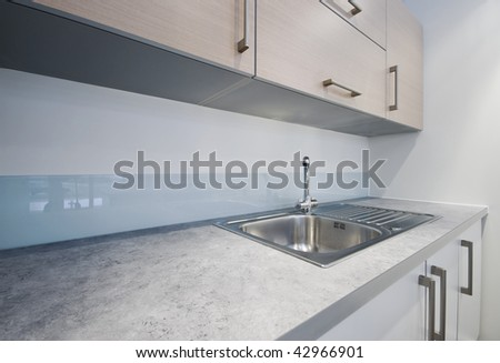 detail shot of a modern kitchen counter - stock photo