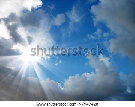 detail shot of blue sky and the sun shining - stock photo