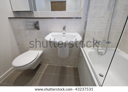 detail shot of modern white ceramic bathroom appliances - stock photo