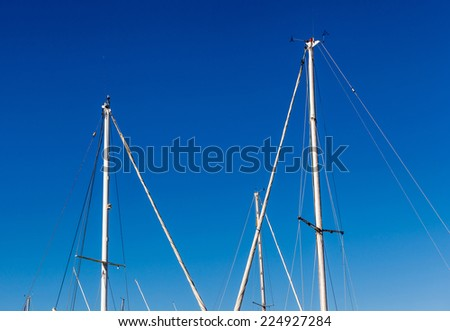 Detail shot of sailing boat poles (mainmasts) in marina. - stock photo