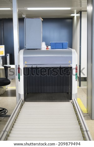 Detail shot of unmanned airport scanner belt - stock photo
