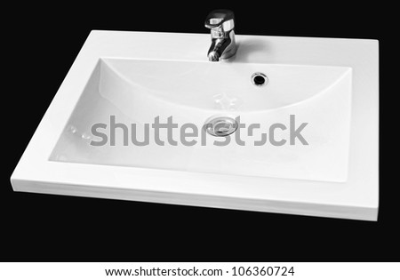 detail shot of white ceramic hand wash basin isolated on black - clipping path - stock photo