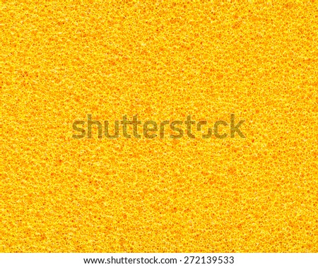 Detail shot of yellow sponge extreme closeup