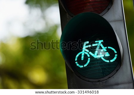 Detail shot with a bicycle traffic light switched to green colour - stock photo