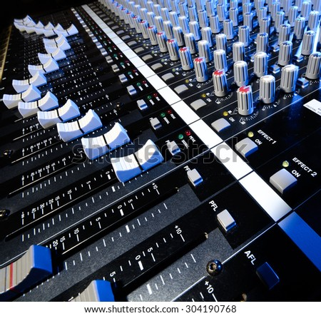 detail sound mixer in natural and blue light with great perspective - stock photo