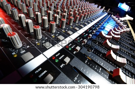 detail sound mixer in red, white and blue light with great perspective, the version with lighting lamp - stock photo