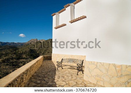 Detail take of a traditional whitewashed Mediterranean building exterior - stock photo