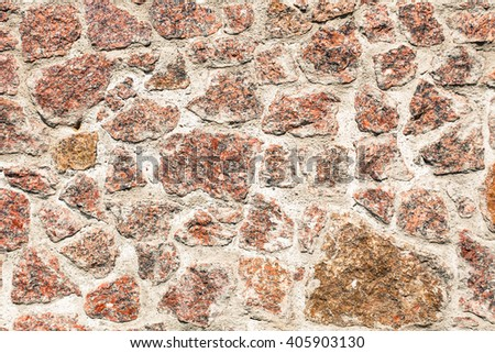 Detail texture of the old gray-brown stone wall - stock photo