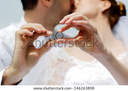 Detail to hands with wedding rings, focused to the rings - stock photo
