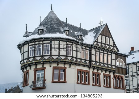 Detail view of a half-timbered house with snowfall in Goslar, Germany