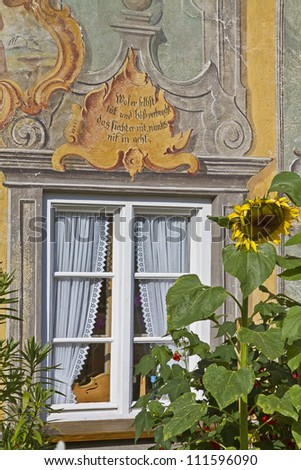 Detail view of a house decorated with paintings in Upper Bavaria