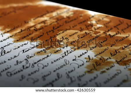 Detail view of an ancient letter with cursive scripture - stock photo