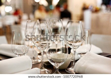 Detail view of empty wine and water glasses on a table in a resaurant