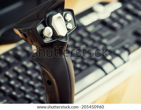 Detail view of game joystick with keyboard. - stock photo